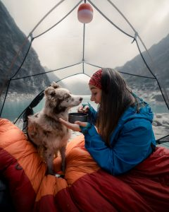 dog and a woman in a tent