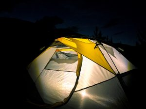 light coming from a green tent at night