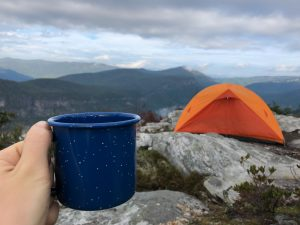 orange tent and a blue coffee cup
