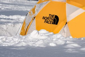 yellow tent in a snow