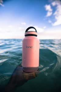 pink waterbottle in the ocean