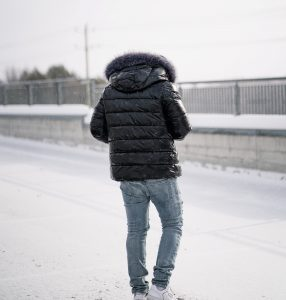 man with black jacket in the winter