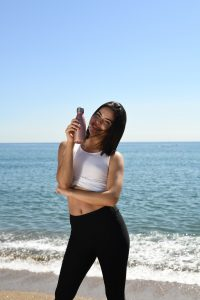 woman in yoga pants holding insulated water bottle